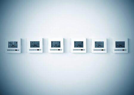 background settings: digital thermostat on white wall