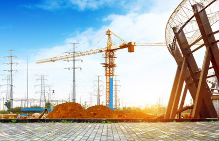 commercial construction: Construction sites, steel structures and cranes under the blue sky. Stock Photo