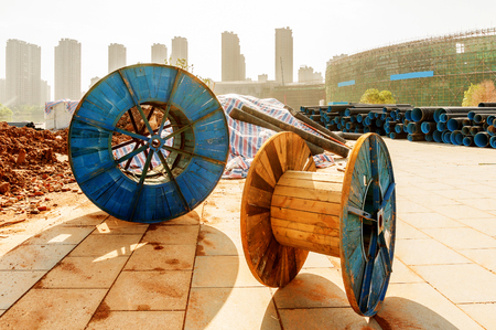 sheathing: Construction sites and discarded cable reels Stock Photo