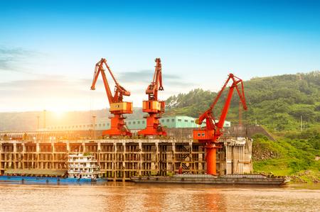 China Yangtze River docks and cranes. Stock Photo