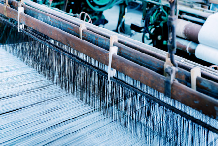 Thread from weaving machine, Abstract background - selective focus.