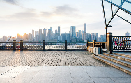 guardrails: Chongqing city skyline, with wooden floors and guardrails. Stock Photo