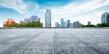 footpath: cityscape and skyline of hangzhou new city in cloud sky on view from marble floor Stock Photo