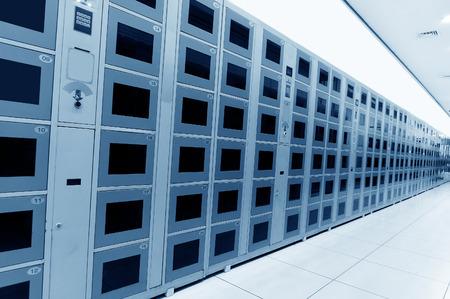 lockers: Supermarket lockers, neatly arranged on the wall.