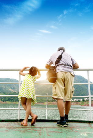 Yangtze River Three Gorges on the cruise, the tourists take their children to enjoy the scenery, Chongqing, China.