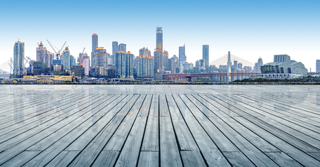 In front of the wooden platform the city skyline, Chongqing, China.