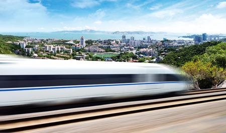 High speed train in urban background, Xiamen, China. Stock Photo