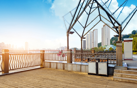 The Yangtze River skyline next to the city, wooden floors and fence, Chongqing, China.
