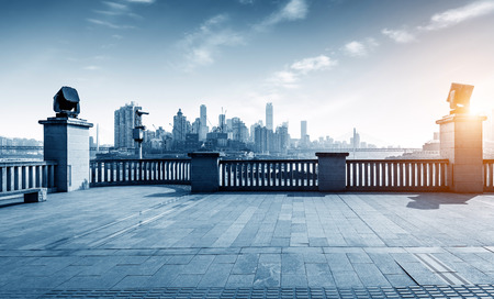 empty office: empty marble floor with cityscape and skyline in cloud sky