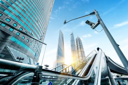 overbridge: China Shanghai Lujiazui financial district, escalators and walking man.
