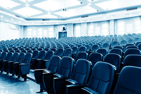 seating: Neatly arranged cinema (theater) seating, blue tones.