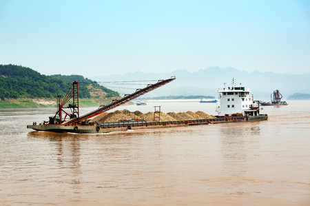 Large dredger in the river, China Three Gorges in Chongqing.