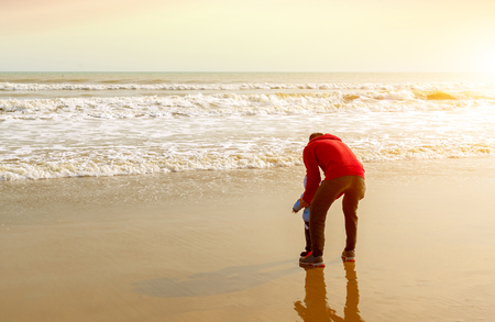 romance sky: Father with his son on the beach Stock Photo