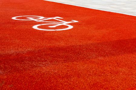 Red bike dedicated road, white bike pattern.