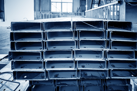 joist: Steel factory floor, stacked with a lot of steel Stock Photo