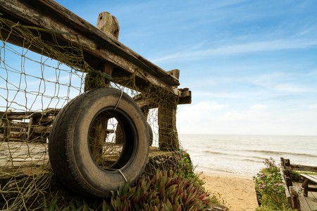 Seaside fence and tires Stock Photo