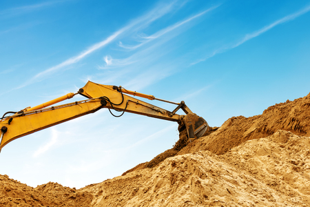 Construction sites, excavators and large amounts of dirt are being worked.