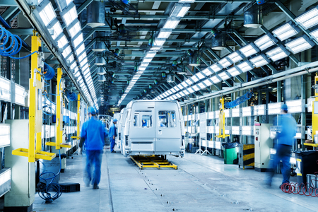 Car production line, skilled workers are working tense.