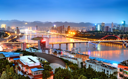 Aerial view of the mountain city of Chongqing, the Yangtze River and the city night.