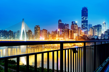 cityscape and skyline of downtown near water of chongqing at night Foto de archivo