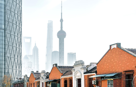 Traditional residential buildings and modern buildings, spanning a century, Shanghai, China.