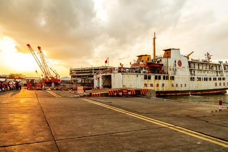 HAIKOU, China - April 20, 2018: Passenger ship wharf, passengers are waiting for departure, evening sky.