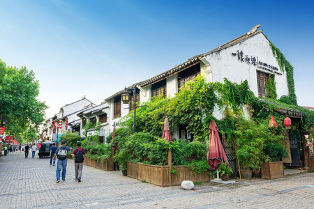 Wuxi, China - June 21, 2018: The Wuxi Grand Canal Old Street, with a total length of 5.5 kilometers, is a famous historical and cultural district. Banco de Imagens - 104323510