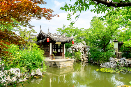 Wuxi, China, a garden of ancient architecture, the text on the pavilion is the introduction of the garden name and garden