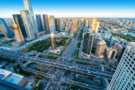 High-rise buildings and viaducts in the city's financial district, Beijing, China. Imagens