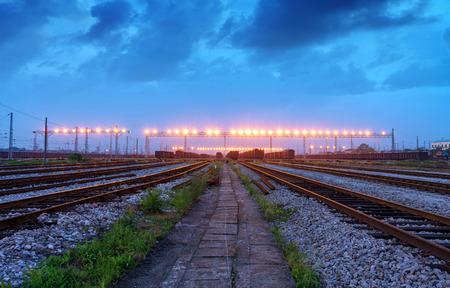 Freight trains and railroad tracks, railway traffic hub night view.