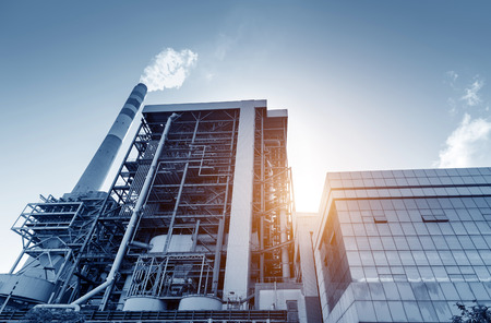 Thermal power plants, exteriors and chimneys. Editorial