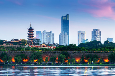 Pagoda and city walls on the shores of Xuanwu Lake, Nanjing, China.