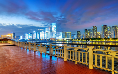 Modern city skyline at night in Fuzhou, China.