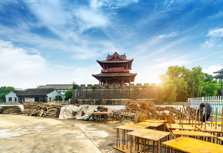Construction site, the ancient city wall is being repaired, Shaoxing, Zhejiang, China.Translation: