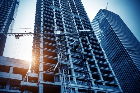 Building construction site, tall skyscrapers and cranes.