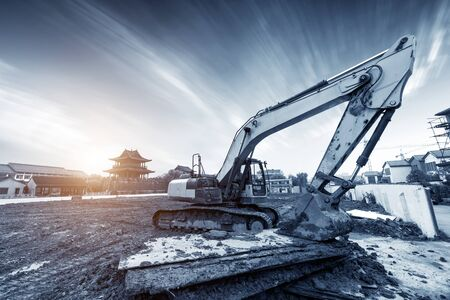 The excavator is working excavation site construction Фото со стока