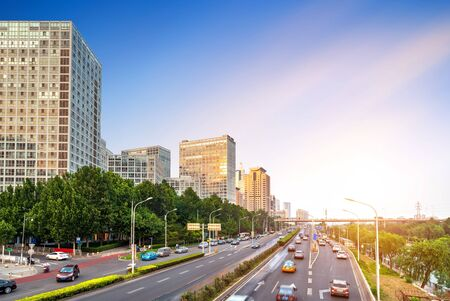 The citys tall buildings and high-speed cars, the urban landscape of Beijing, China. Фото со стока