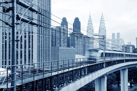 subway train with skyscraper in the modern city, in Chongqing, china. 版權商用圖片