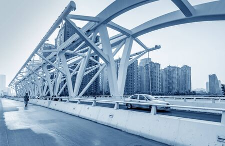 Bridge and high-speed car, Tianjin, China cityscape. Stock Photo