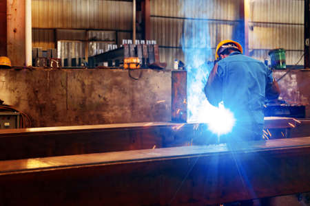 Workers at work, ongoing welding operation. Stockfoto