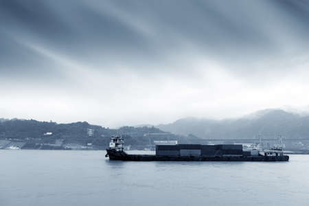 On the Yangtze River, cargo ships shuttle back and forth, and the
