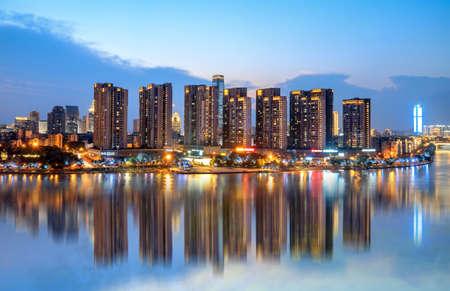 Modern buildings and reflections, Liuzhou, China. Foto de archivo