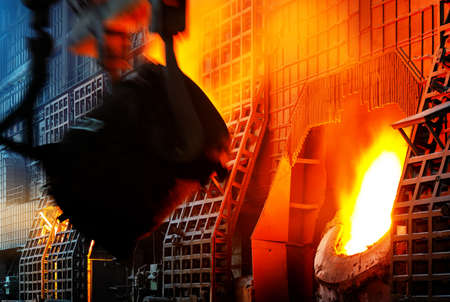 steelworker at work pouring metal in the workshop
