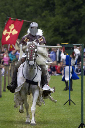 Knights jousting warwick castle England uk Stock Photo