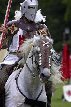 showmanship: Knights jousting warwick castle England uk Stock Photo