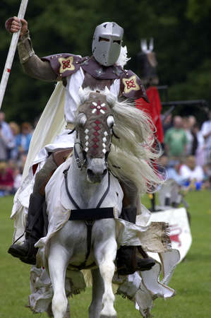 charger: Knights jousting warwick castle England uk Stock Photo