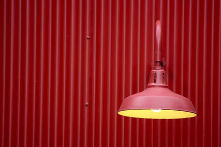 Red light against red metal background