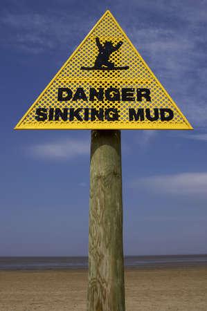 quicksand: Danger sinking mud sign, sand point beach England uk