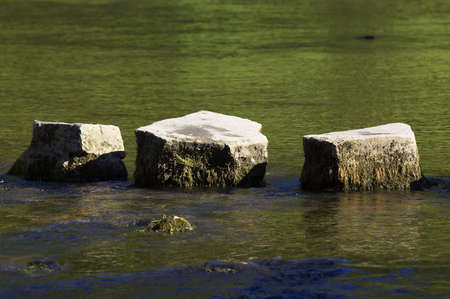 stepping: 3 stepping stones in river Stock Photo