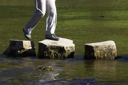 crossing three stepping stones in a river Stock Photo - 228002
